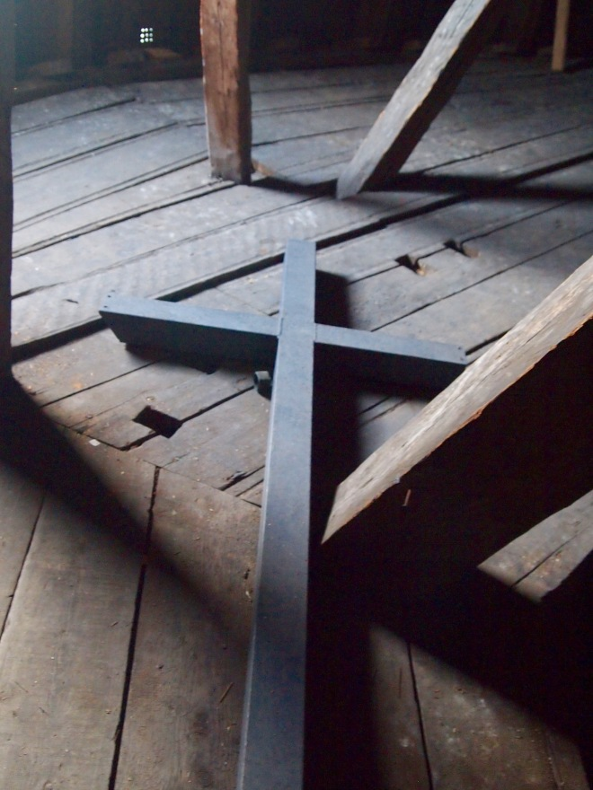 A cross on the clock tower floor